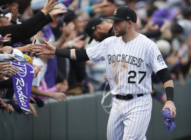 Colorado Rockies shortstop Trevor Story is congratulated by fans after the ninth inning of a baseball game against the Washington Nationals Sunday, Sept. 30, 2018, in Denver. The Rockies won 12-0. (AP Photo/David Zalubowski)