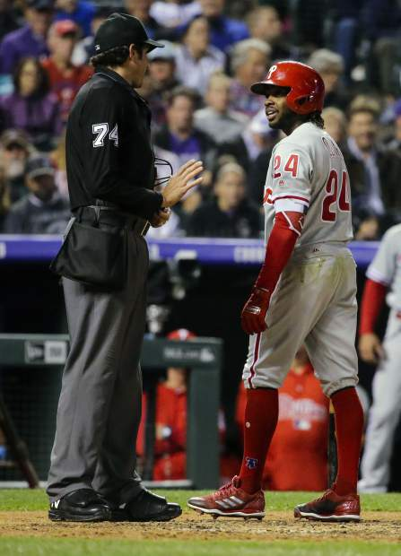 Philadelphia Phillies' Roman Quinn argues a called strike with home plate umpire John Tumpane out fourth inning of a baseball game against the Colorado Rockies on Tuesday, Sept. 25, 2018, in Denver. (AP Photo/Jack Dempsey)