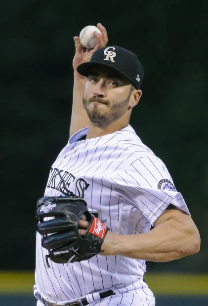 Colorado Rockies starting pitcher Chad Bettis throws against the Philadelphia Phillies during the first inning of a baseball game on Tuesday, Sept. 25, 2018, in Denver. (AP Photo/Jack Dempsey)