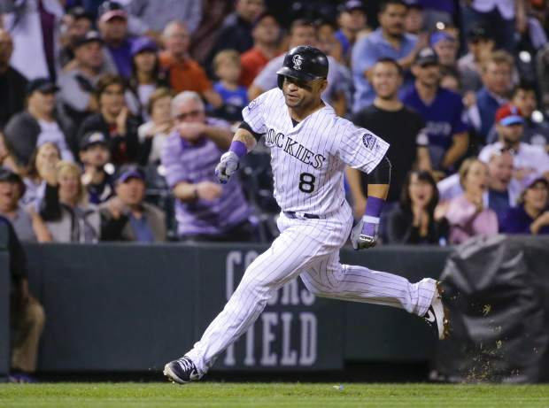 Colorado Rockies' Gerardo Parra heads for home plate to score against the Philadelphia Phillies during the sixth inning of a baseball game on Monday, Sept. 24, 2018, in Denver. (AP Photo/Jack Dempsey)