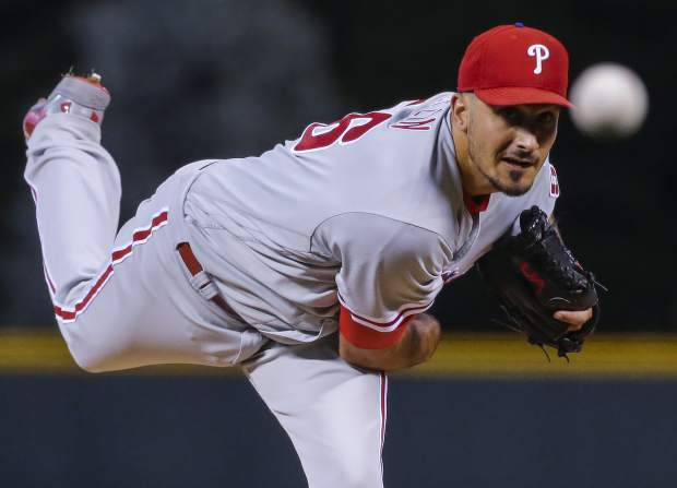 Philadelphia Phillies starting pitcher Zach Eflin throws to the plate against the Colorado Rockies during the first inning of a baseball game on Monday, Sept. 24, 2018, in Denver. (AP Photo/Jack Dempsey)
