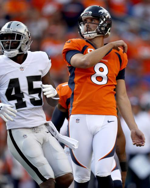 Denver Broncos kicker Brandon McManus (8) watches his game-winning field goal split the uprights as Oakland Raiders defensive back Dominique Rodgers-Cromartie (45) looks on during the second half of an NFL football game, Sunday, Sept. 16, 2018, in Denver. The Broncos won 20-19. (AP Photo/David Zalubowski)