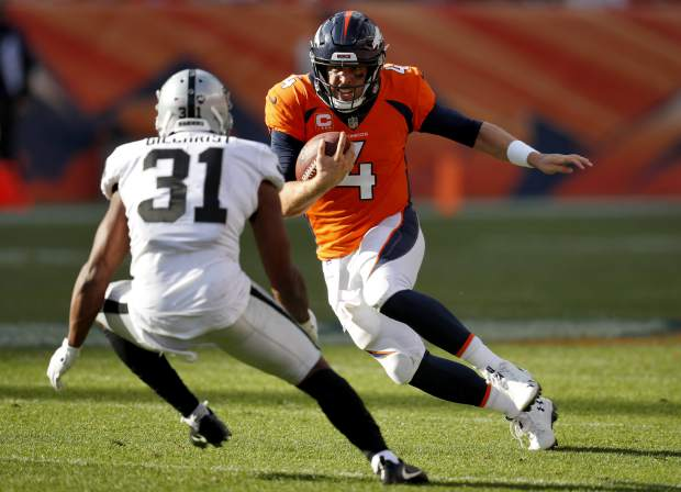 Denver Broncos quarterback Case Keenum (4) runs in for a touchdown as Oakland Raiders defensive back Marcus Gilchrist (31) defends during the second half of an NFL football game, Sunday, Sept. 16, 2018, in Denver. (AP Photo/David Zalubowski)
