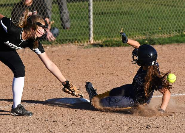 Rifle Bear Delaney Phillips safely slides into third base during Thursday night's game against the Meeker Cowboys in Rifle. The Cowboys scored four runs in the third inning and another three in the fourth.