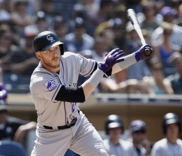 Colorado Rockies' Trevor Story hits an RBI-double during the sixth inning of a baseball game against the San Diego Padres in San Diego, Sunday, Sept. 2, 2018. (AP Photo/Alex Gallardo)
