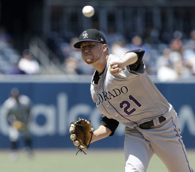 Colorado Rockies starting pitcher Kyle Freeland throws to a San Diego Padres batter during the first inning of a baseball game in San Diego, Sunday, Sept. 2, 2018. (AP Photo/Alex Gallardo)
