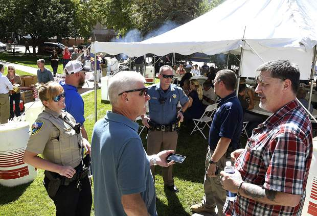 Community members enjoy some lunchtime conversation with local law enforcement and first responders Tuesday in front of the Garfield County Courthouse as part of the fourth annual Burgers for Badges put on by the Glenwood Springs Elks Lodge.