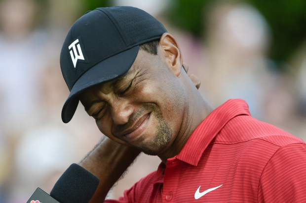 Tiger Woods tries to maintain his composure while getting choked up being interviewed after winning the Tour Championship golf tournament Sunday, Sept. 23, 2018, in Atlanta. (AP Photo/John Amis)