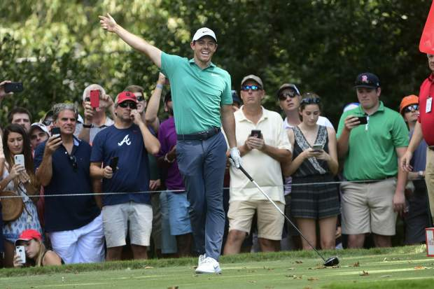 Rory McIlroy reacts after teeing off on the seventh hole during the final round of the Tour Championship golf tournament Sunday, Sept. 23, 2018, in Atlanta. (AP Photo/John Amis)