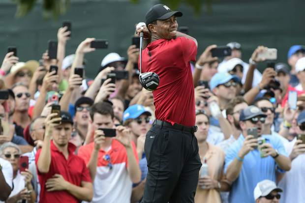 Tiger Woods hits from the third tee during the final round of the Tour Championship golf tournament Sunday, Sept. 23, 2018, in Atlanta. (AP Photo/John Amis)