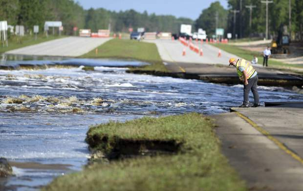 Flooding from Sutton Lake has washed away part of U.S. 421 in New Hanover County just south of the Pender County line in Wilmington, N.C., Friday, Sept. 21, 2018. (Matt Born /The Star-News via AP)