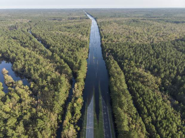 S.C. Highway 22 is flooded between SC-90 and SC-905 on Saturday, Sept. 22, 2018. The blocked road has traffic snarled around Conway, S.C. (Jason Lee/The Sun News via AP)