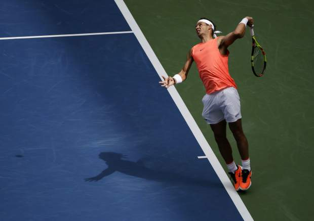 Rafael Nadal, of Spain, serves to Nikoloz Basilashvili, of Georgia, during the fourth round of the U.S. Open tennis tournament, Sunday, Sept. 2, 2018, in New York. (AP Photo/Carolyn Kaster)