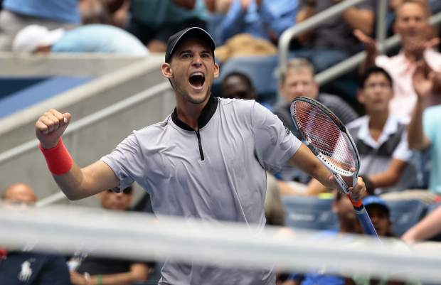 Dominic Thiem, of Austria, reacts after defeating Kevin Anderson, of South Africa, during the fourth round of the U.S. Open tennis tournament, Sunday, Sept. 2, 2018, in New York. (AP Photo/Andres Kudacki)