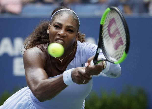 Serena Williams returns a shot to Kaia Kanepi, of Estonia, during the fourth round of the U.S. Open tennis tournament, Sunday, Sept. 2, 2018, in New York. (AP Photo/Carolyn Kaster)