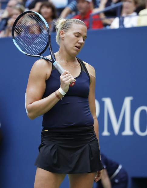 Kaia Kanepi, of Estonia, reacts after losing a point to Serena Williams during the fourth round of the U.S. Open tennis tournament, Sunday, Sept. 2, 2018, in New York. (AP Photo/Carolyn Kaster)