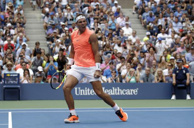 Rafael Nadal, of Spain, reacts after defeating Nikoloz Basilashvili, of Georgia, during the fourth round of the U.S. Open tennis tournament, Sunday, Sept. 2, 2018, in New York. (AP Photo/Carolyn Kaster)