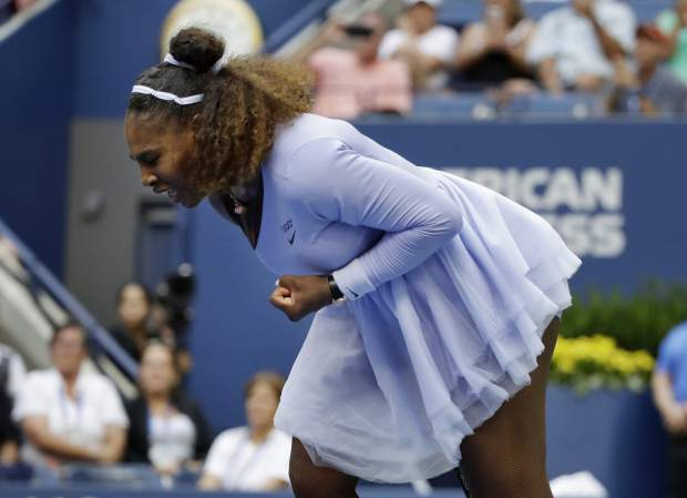 Serena Williams reacts after defeating Kaia Kanepi, of Estonia, during the fourth round of the U.S. Open tennis tournament, Sunday, Sept. 2, 2018, in New York. (AP Photo/Carolyn Kaster)