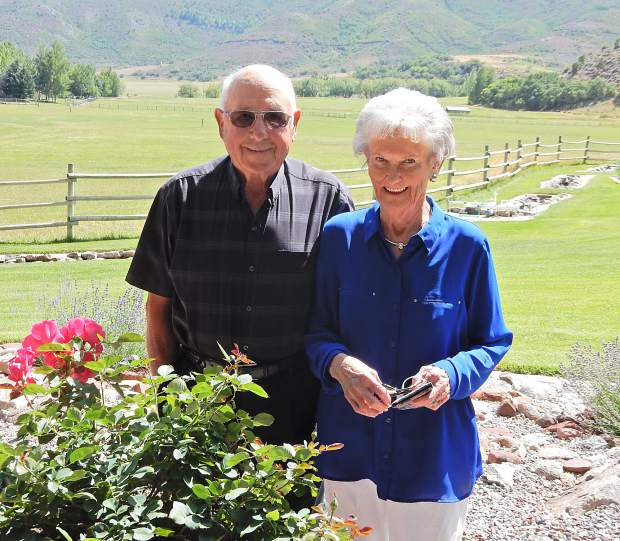 Jerry and Judy Gerbaz stand in a fabulous garden of their midvalley home, which they built in 1962. Jerry's grandfather bought a ranch in the area in 1897.