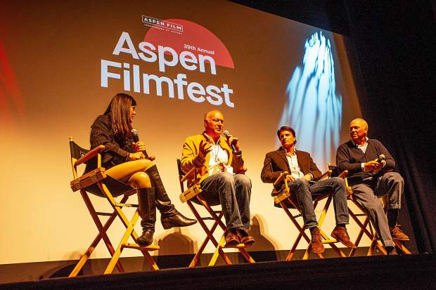 "Aspen Filmfest executive director Susan Wrubel, Andy Godfrey, director John Breen, and Mark Godfrey on stage at the Wheeler after the screening of the documentary ""3 Days 2 Nights"" about the brothers confronting the long-festering trauma of a 1974 plane crash that killed their parents and two siblings."