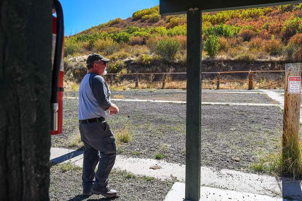 Ralph Delaney takes a walk through the South Canyon Gun Range on Tuesday afternoon.