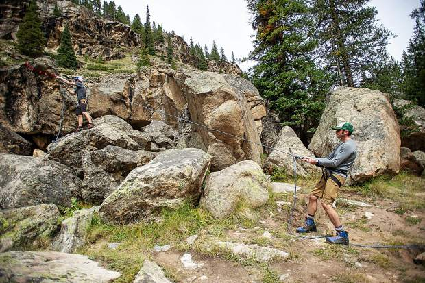 Aspen Alpine Guide Nate Rowland, right, and David Rubin demonstrate how to use natural features for mountaineering up on Independence Pass on August 25 for a field planning and safety clinic.