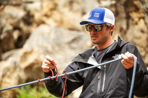 Aspen Alpine Guide Nate Rowland demonstrates how to tie a prusik knot August 25 for a field planning and safety clinic up on Independence Pass.