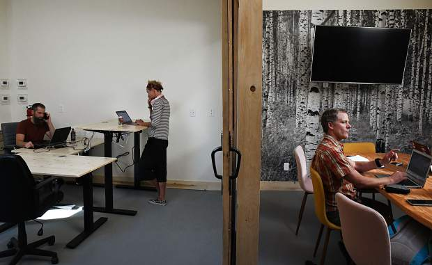 People use two work different work areas at The Coop in Glenwood Springs.