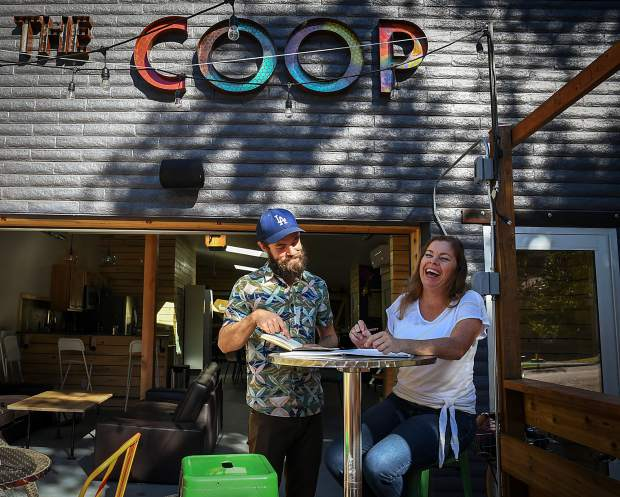 Bud Tymczyszyn and Lisa Pridemore use the outdoor seating at The Coop on Cooper Avenue in downtown Glenwood Springs.