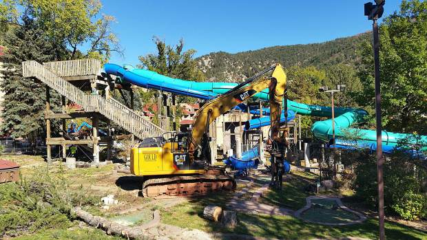 Crews are beginning to remove the waterslides at Glenwood Hot Springs as they prepare for the multi-million-dollar renovation of the west end of the property.