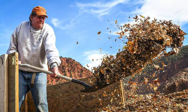 Glenwood Springs resident Dale Titus gets rid of the leaves from his yard at the leaf drop-off spot at the old rodeo grounds in south Glenwood on Monday morning.