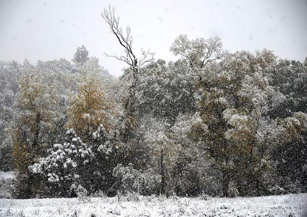 It was near white-out conditions in the Iron Bridge neighborhood south of Glenwood Springs Thursday, as winter made an early appearence with substantial snowfall in the Roaring Fork Valley.