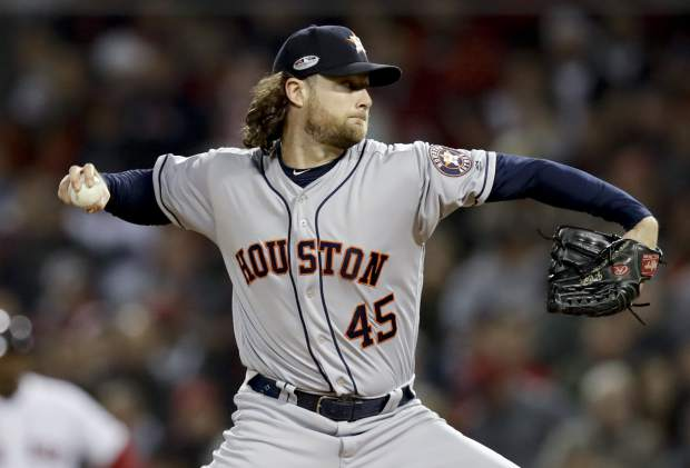 Houston Astros starting pitcher Gerrit Cole throws against the Boston Red Sox during the first inning in Game 2 of a baseball American League Championship Series on Sunday, Oct. 14, 2018, in Boston. (AP Photo/Charles Krupa)