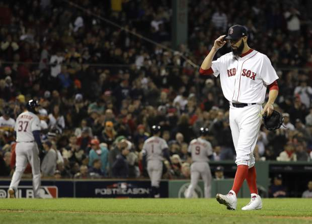 Boston Red Sox starting pitcher David Price is taken out of the game against the Houston Astros during the fifth inning in Game 2 of a baseball American League Championship Series on Sunday, Oct. 14, 2018, in Boston. (AP Photo/David J. Phillip)