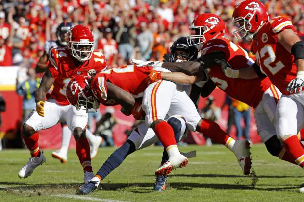 Kansas City Chiefs running back Kareem Hunt (27) crosses into the end zone for a touchdown during the second half of an NFL football game against the Denver Broncos in Kansas City, Mo., Sunday, Oct. 28, 2018. (AP Photo/Charlie Riedel)