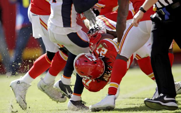Kansas City Chiefs running back Kareem Hunt (27) lands into the end zone for a touchdown during the second half of an NFL football game against the Denver Broncos in Kansas City, Mo., Sunday, Oct. 28, 2018. (AP Photo/Orlin Wagner)