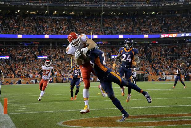 Kansas City Chiefs tight end Travis Kelce (87) is knocked out of bounds for an incomplete pass by Denver Broncos defensive back Darian Stewart (26) during the second half of an NFL football game, Monday, Oct. 1, 2018, in Denver. (AP Photo/Jack Dempsey)