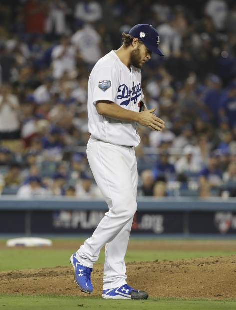 Los Angeles Dodgers pitcher Clayton Kershaw walks back to the mound after a solo home run by Boston Red Sox's Mookie Betts during the sixth inning in Game 5 of the World Series baseball game on Sunday, Oct. 28, 2018, in Los Angeles. (AP Photo/David J. Phillip)