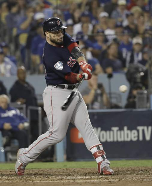Boston Red Sox's Steve Pearce hits his second home run during the eighth inning in Game 5 of the World Series baseball game against the Los Angeles Dodgers on Sunday, Oct. 28, 2018, in Los Angeles. (AP Photo/David J. Phillip)