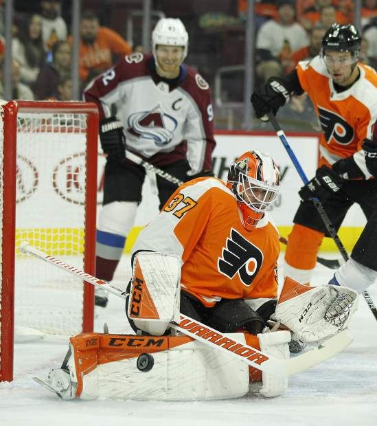 Philadelphia Flyers' Brian Elliott turns away a shot on goal during the first period of an NHL hockey game against the Colorado Avalanche, Monday, Oct. 22, 2018, in Philadelphia. (AP Photo/Tom Mihalek)