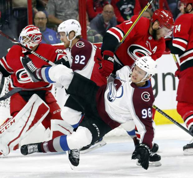 Carolina Hurricanes' Jordan Staal (11) shoves the Colorado Avalanche's Mikko Rantanen (96), of Finland, to the ice during the first period of an NHL hockey game in Raleigh, N.C., Saturday, Oct. 20, 2018. (AP Photo/Chris Seward)