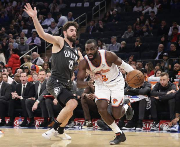 New York Knicks' Tim Hardaway Jr. (3) drives past Brooklyn Nets' Joe Harris (12) during the first half of an NBA basketball game Monday, Oct. 29, 2018, in New York. The Knicks won 115-96. (AP Photo/Frank Franklin II)
