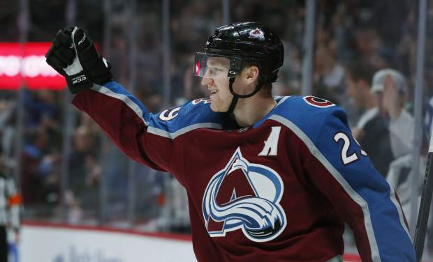 FILE - In this Oct. 26, 2018, file photo, Colorado Avalanche center Nathan MacKinnon celebrates after scoring a goal against the Ottawa Senators in the third period of an NHL hockey game in Denver. The Colorado Avalanche trio of MacKinnon, Gabriel Landeskog and Mikko Rantanen form the top line in hockey. The speedy group has a combined 55 points this season as Rantanen leads the league in points. The trio has helped lift Colorado to one of the best marks in the Western Conference this season. (AP Photo/David Zalubowski, File)