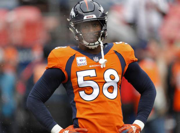 FILE - In this Oct. 14, 2018, file photo, Denver Broncos linebacker Von Miller (58) warms up prior to an NFL football game against the Los Angeles Rams, in Denver. The Arizona Cardinals can't run the ball, the Denver Broncos can't stop the run. The ground game could be the deciding factor when the two struggling teams meet Thursday night, Oct. 18. (AP Photo/David Zalubowski, File)