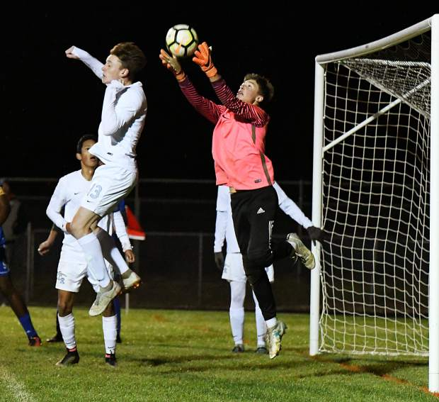 The Coal Ridge Titan goalie catches the ball in the box during Thursday night's game against the Roaring Fork Rams.