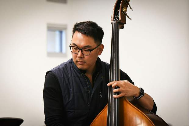 Bassist Young Heo performs with the Dallas String Quartet for music students at Glenwood Springs High School on Tuesday morning.