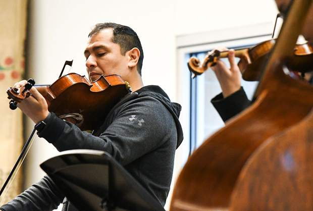 Dallas String Quartet founder Ion Zanca performs with other band members for music students at Glenwood Springs High School on Tuesday morning.