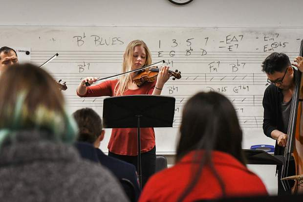 Dallas String Quartet violinist Melissa Priller performs with other band members for music students at Glenwood Springs High School on Tuesday morning.