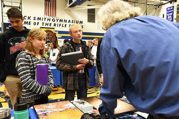 In this fall 2018 photo, local photographer George Cutting speaks to students about photographer jobs at a GlenX career fair held at Rifle High School.