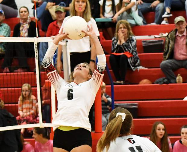 Glenwood Springs Demon Reese Goluba sets the ball for Ashley Emery during Tuesday night's game against the Rifle Bears.